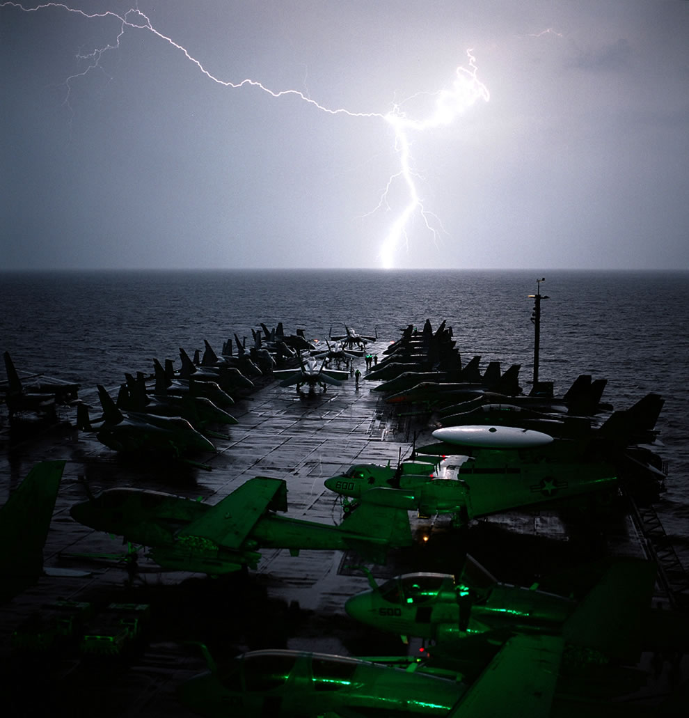 Lightning strikes light up the bow of USS Abraham Lincoln