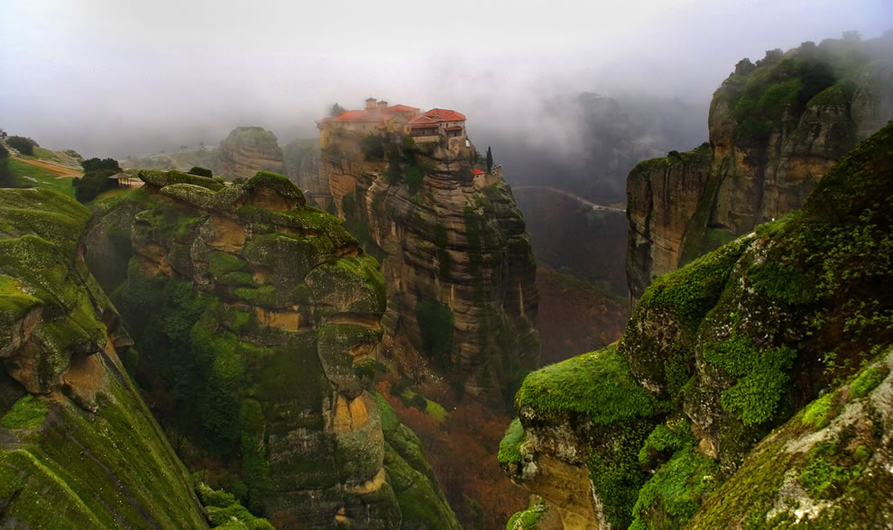 "The caves in Meteora, Greece, had inhabitants for fifty millennia, but due to raids, ""hermit monks"" moved to the safety of sandstone rock pinnacles in the 9th century and began building monasteries. More monks and nuns came, building more monasteries perched high upon the cliffs."