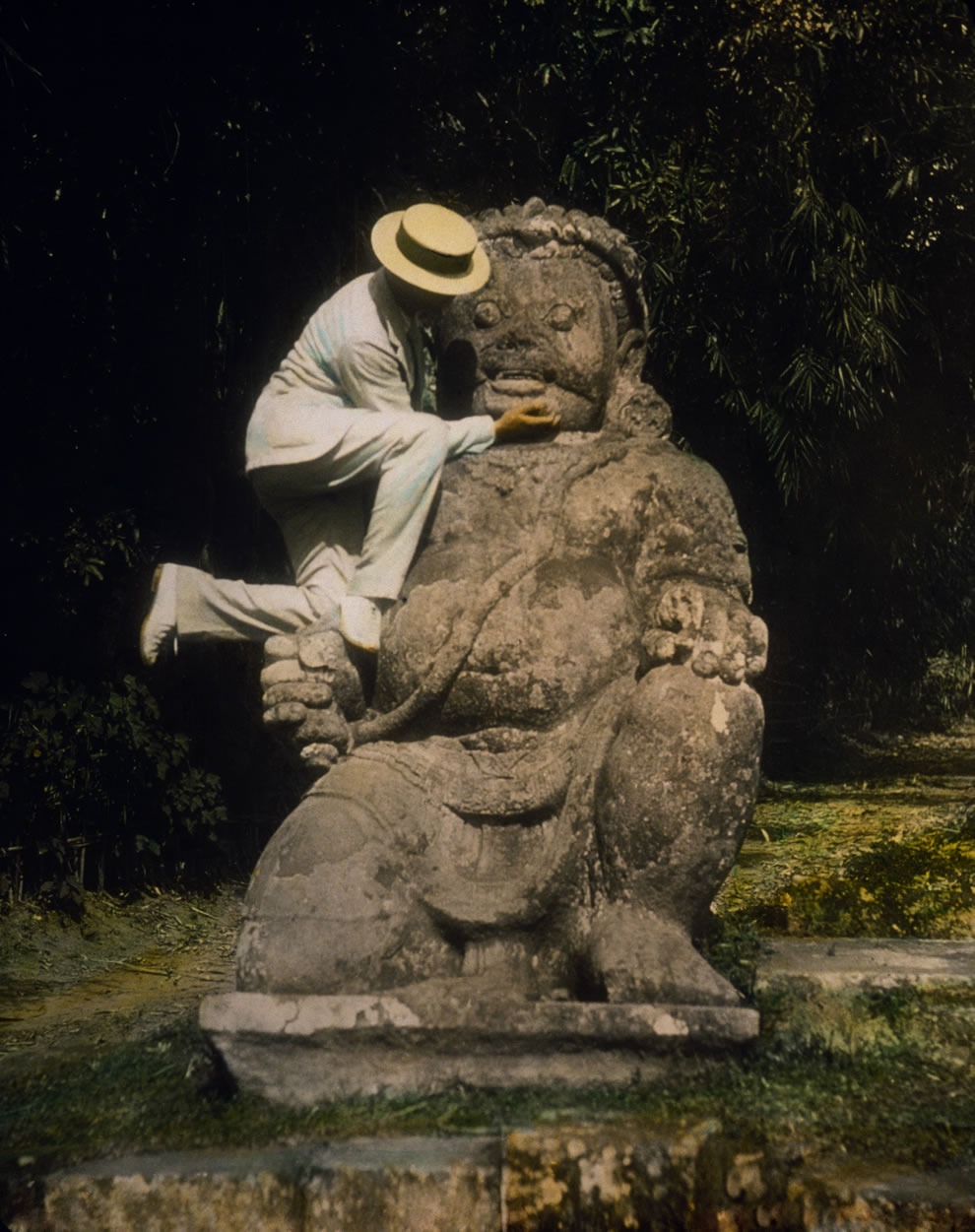 1895 hand-tinted lantern slide of a guardian statue at Borobudur