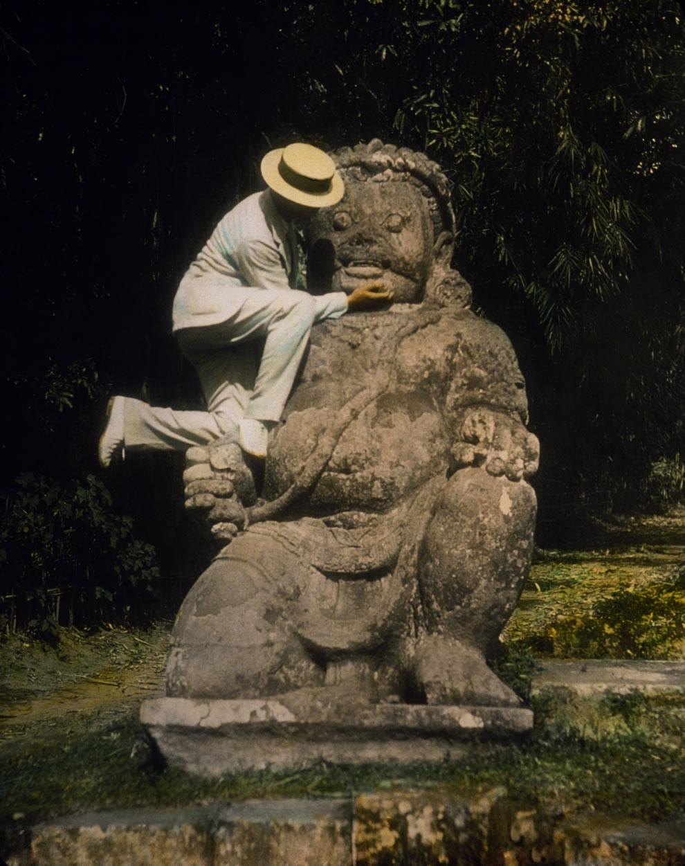 1895 hand-tinted lantern slide of a guardian statue at Borobudur