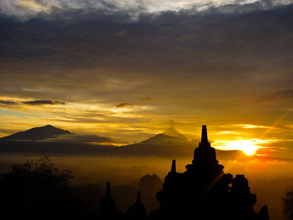 sunrise was taken at the Borobudur Temple, Magelang, Central Java, Indonesia. The two mountains in the background are Mount Merbabu and Mount Merapi