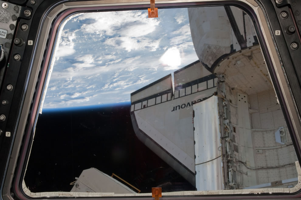 A portion of the docked space shuttle Endeavour is featured in this image photographed by an STS-134 crew member from a Cupola window of the ISS