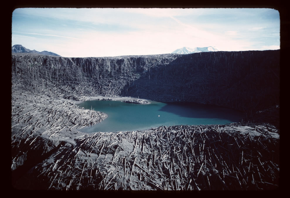 Aerial view, blowdown and Fawn Lake - Note Mount St. Helens in the background