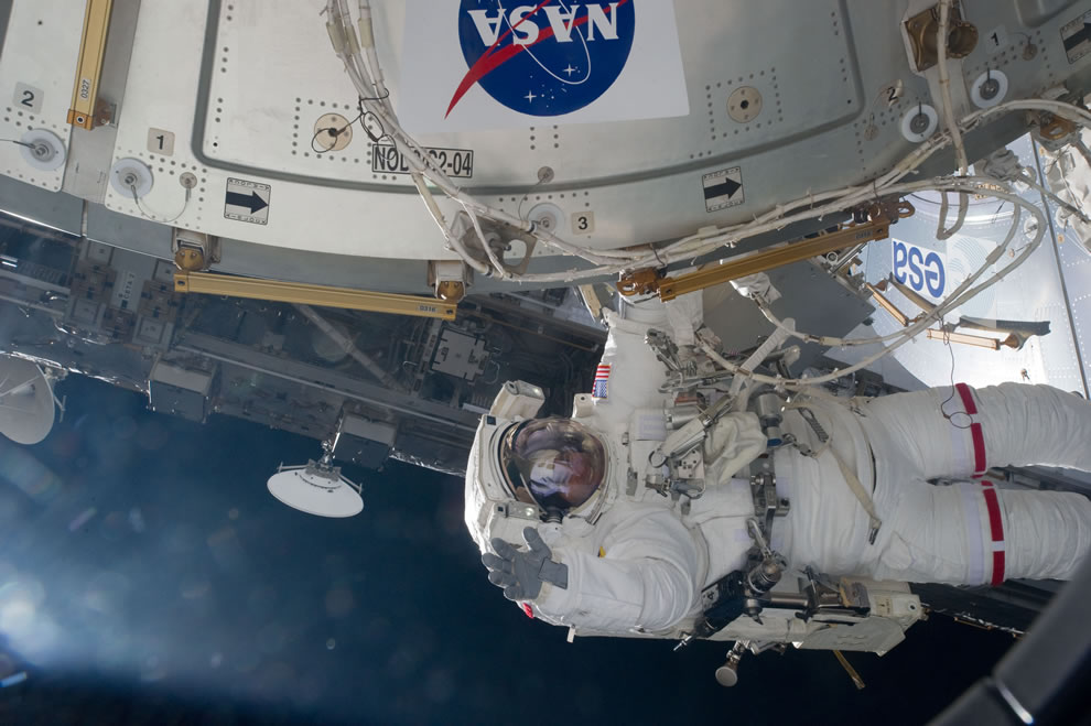 NASA astronaut Greg Chamitoff, STS-134 mission specialist, waving May 20