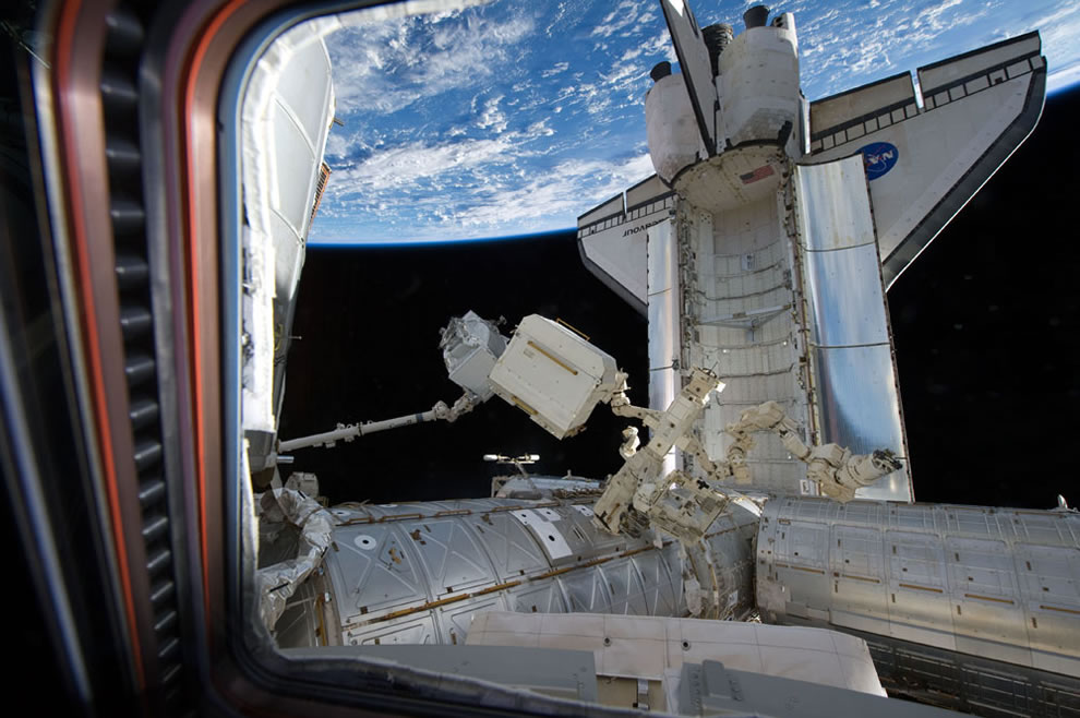 The Alpha Magnetic Spectrometer 2 is transferred from space shuttle Endeavour's payload bay for installation on the station's starboard truss, on May 19, 2011