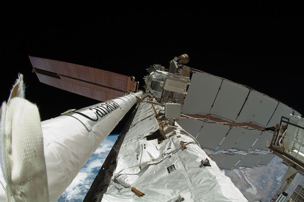 mAY 27 newly-attached 50-foot-long Enhanced International Space Station Boom Assembly (left) is featured in this image photographed by a spacewalker
