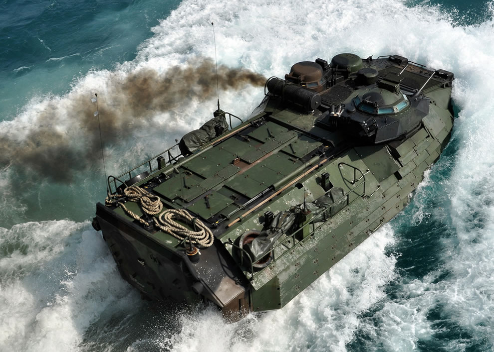 U.S. Marine Corps AAVP7A1 assault amphibian vehicle assigned to the 31st Marine   Expeditionary Unit launches from the well deck of the amphibious transport dock USS Denver