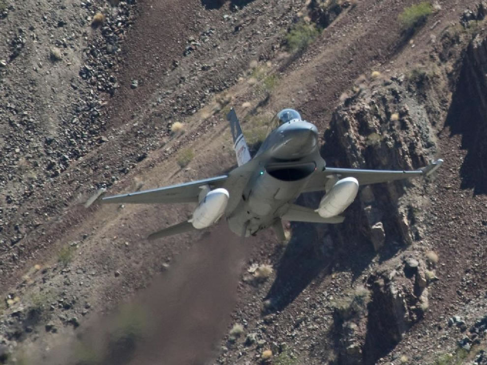 U.S. Air Force's ACAT F-16D flew through   Sierra Nevada canyons and past peaks during ground collision avoidance test flights.