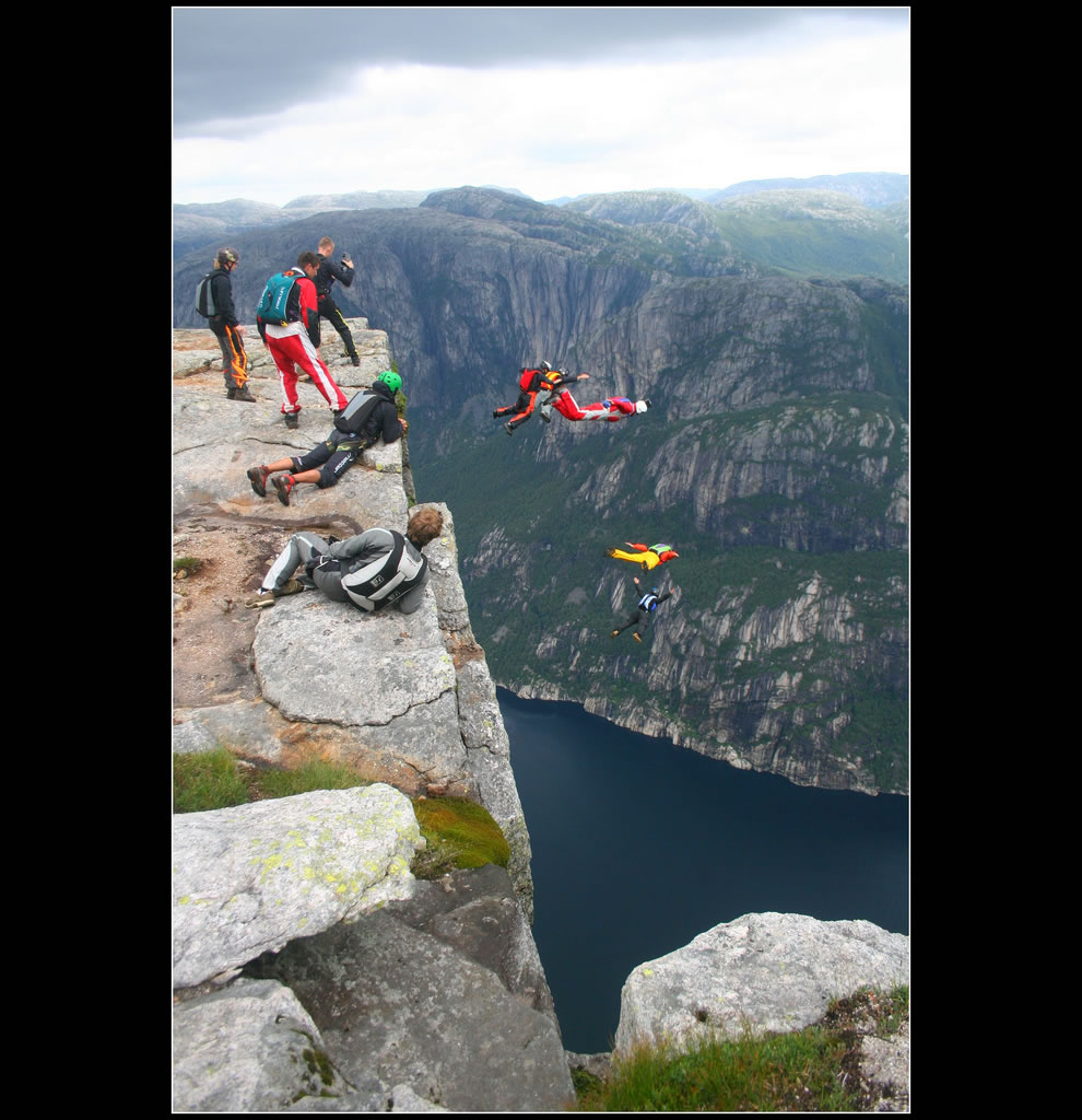 Kjerag cliff in Norway - basejumpers