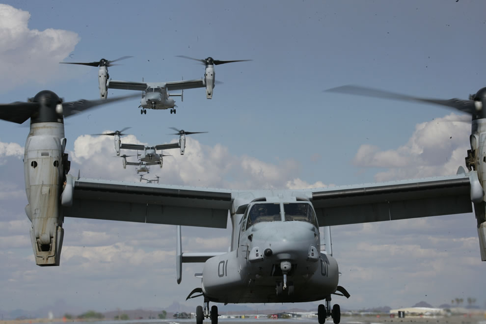 MV-22 Osprey tiltrotor aircraft land on the flight line at Marine Corps Air Station Yuma, Ariz