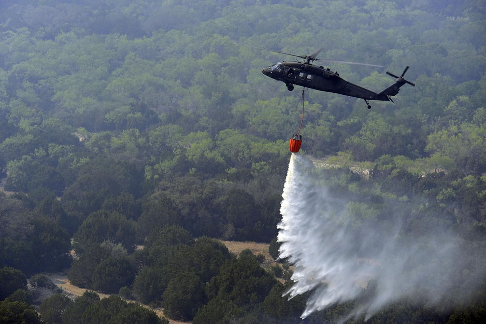 Texas National Guard UH-60 Black Hawk helicopter with 600 gallons of water to fight wildfires