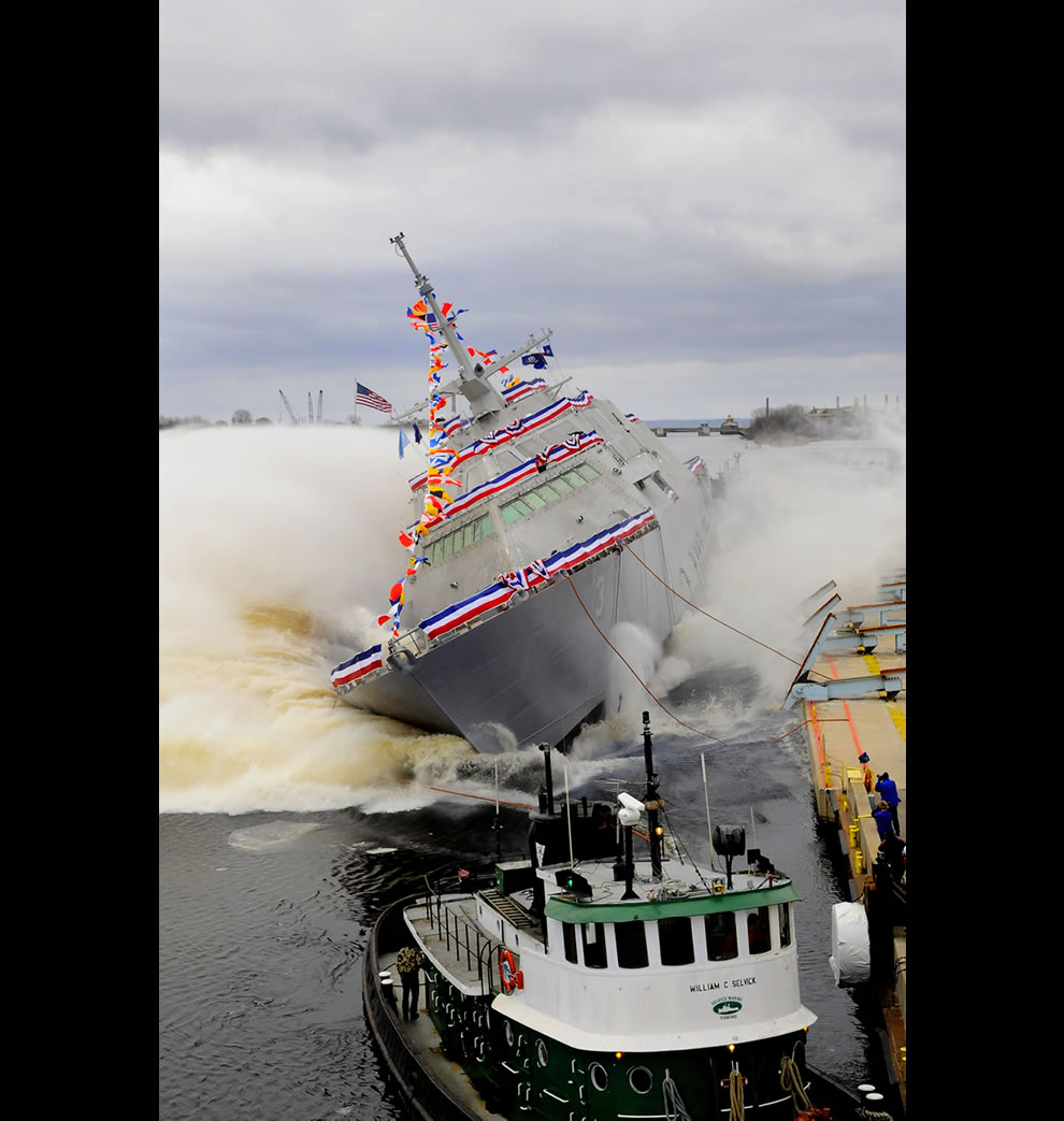 The littoral combat ship Pre-Commissioning Unit Fort Worth (LCS 3) launches into the Menominee River during the ship's christening ceremony