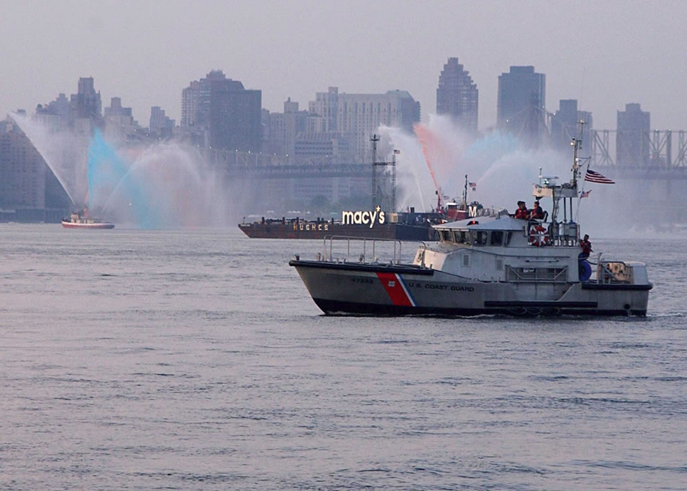 A U.S. Coast Guard rescue boat, from Coast Guard Station Sandy Hook, NJ, patrols the East River near the Macy's fireworks barges