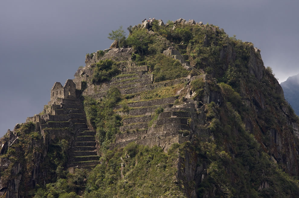 A few ruined buildings and structural terraces remain on Wayna Picchu, the summit often seen behind Machu Picchu