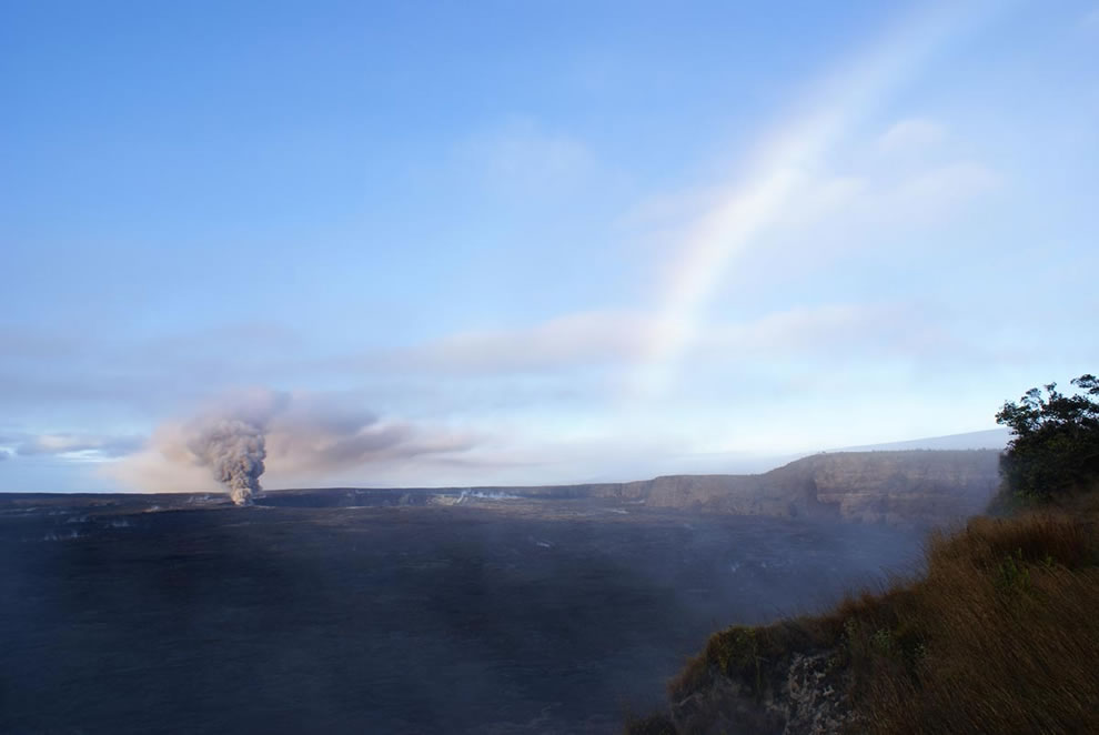 Ash-laden Halema`uma`u plume captures the rainbow in the early morning light. Photo taken from Steaming Bluffs