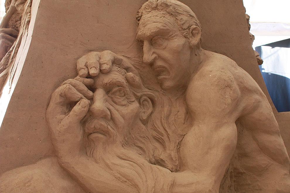 Dante's Inferno in sand sculptures circle 8 Count Ugolino Gnawing the Head of the Archbishop