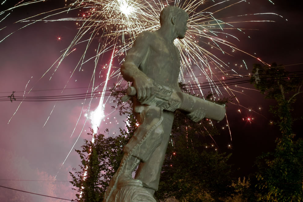 Fireworks erupt over the John Basilone Statue in Raritan, NJ