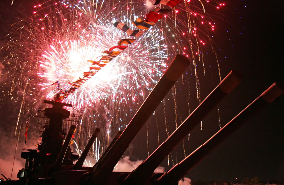 Fireworks illuminate the skies over Battleship North Carolina - newest Virginia-class nuclear attack submarine USS North Carolina