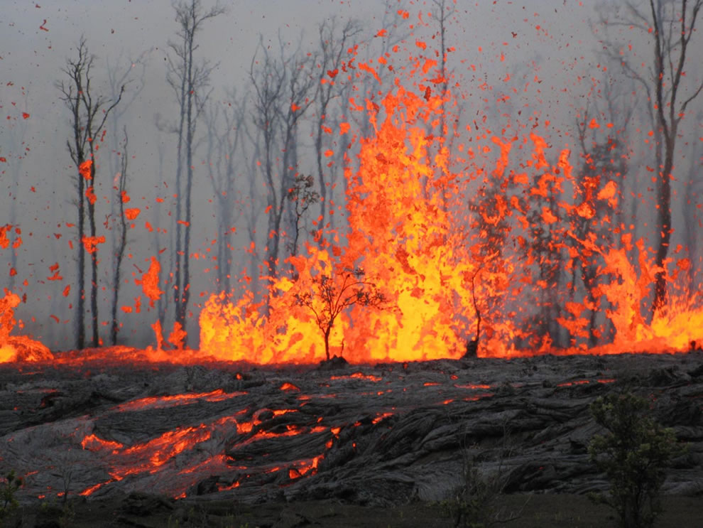 Fissure erupting spatter and producing lava flows between Pu`u `Ō `ō Crater and Nāpau