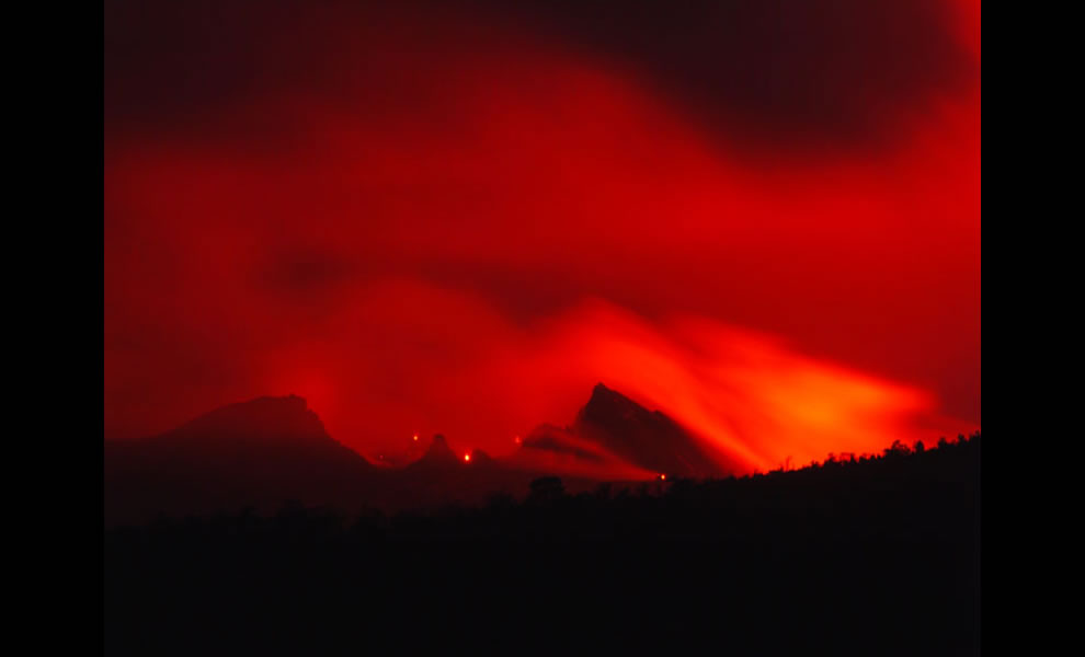 Glow from south of cone comes from lava and new vent at southeast base of   Pu`u `O`o