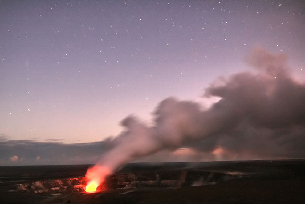 Halemaumau Crater glows under the clear sky