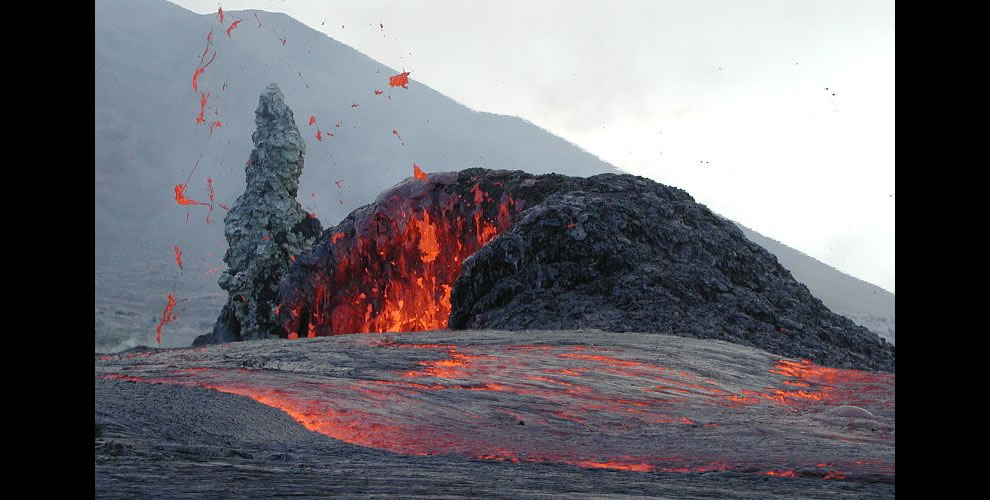 Lava spattering from the west vent in West Gap Pit of Pu`u `O`o, Hawaii