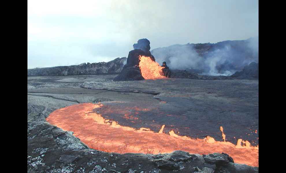 Lava spilling and spattering from East Pond Vent and feeding lava flow that is filling east end of Pu`u `O`o's crater. Cone at East Pond Vent is about 8 m high