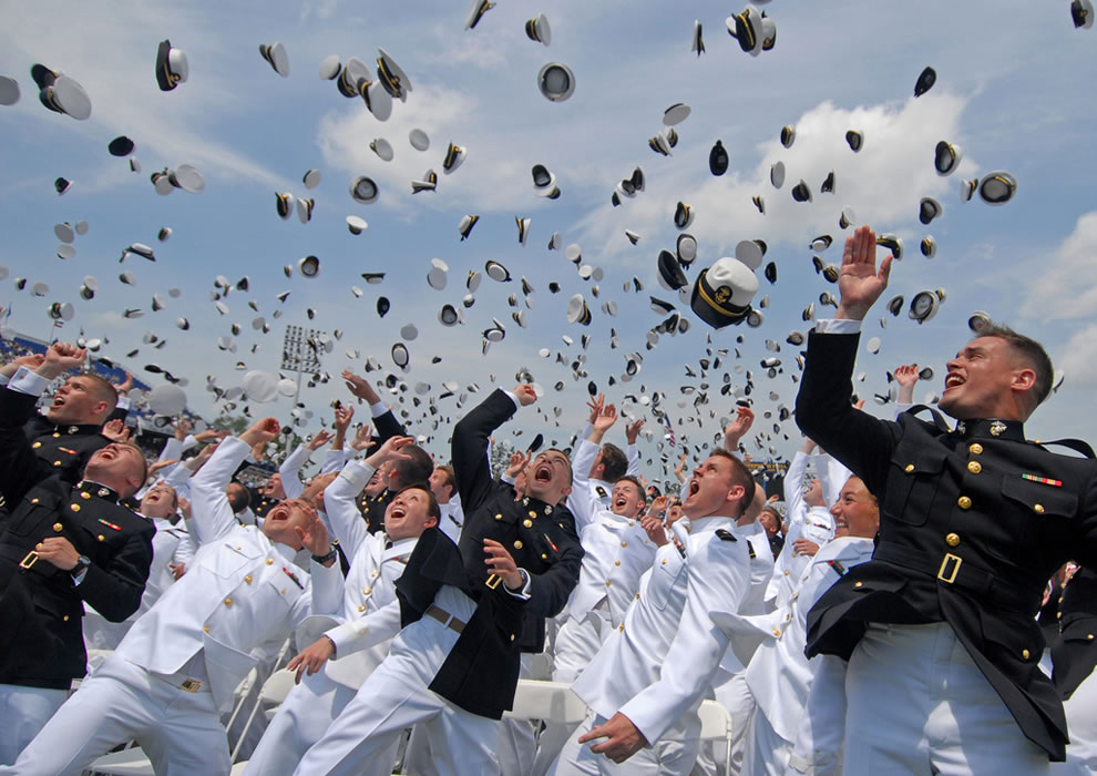 Newly commissioned Navy and Marine Corps officers toss their hats during the U.S. Naval Academy Class of 2011 graduation and commissioning ceremony