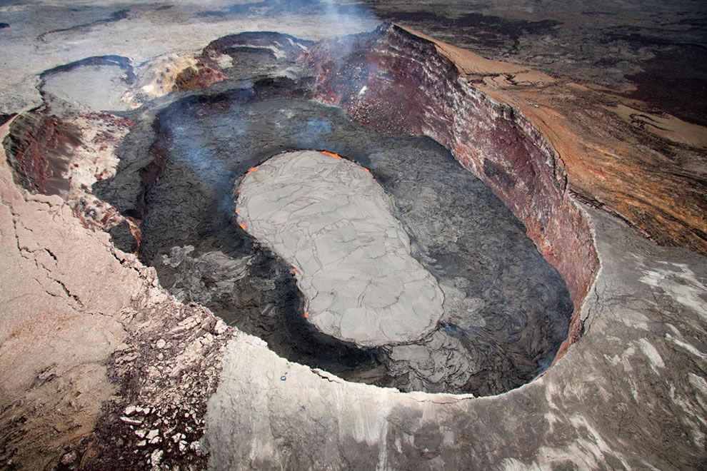 The active lava lake in Pu`u `Ō `ō and its levee; lava lake's shape makes it look like a huge slipper