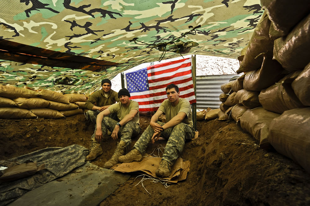 inside an improvised shelter decorated with an American flag