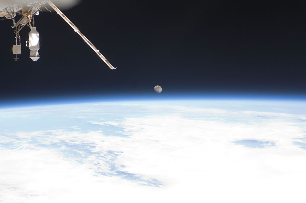 Earth's horizon and the moon during the week and a half period that the orbiting complex was hosting Atlantis and its crew for the final Space Shuttle Program mission