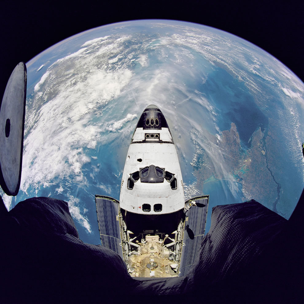Fish-eye view of the Space Shuttle Atlantis as seen from the Russian Mir space station during the STS-71 mission