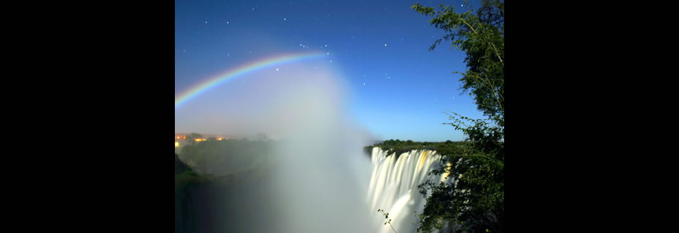 Lunar Rainbow taken from the Zambia side of Victoria Falls. The constellation Orion is visible behind the top of the moonbow