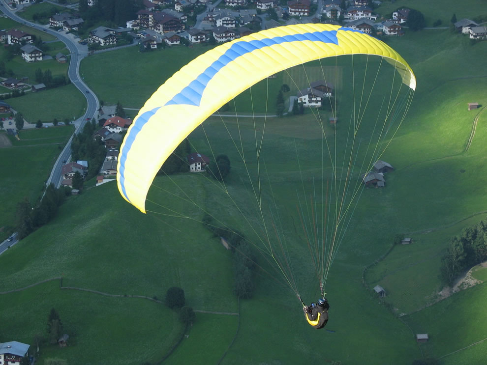 Paraglider on air, above Neustift, Stubai Tal, Tirol, Austria