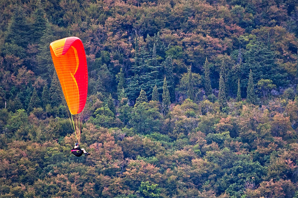 Paragliding with Italian Autumn backdrop