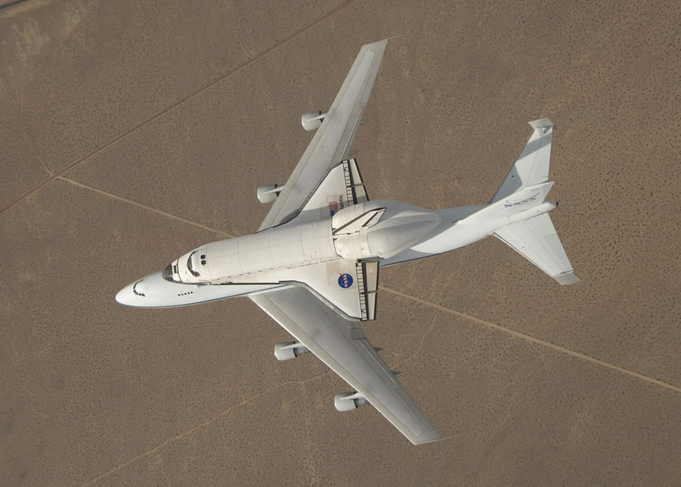 overhead view is of Atlantis atop a modified 747 as the craft flew over California's high desert