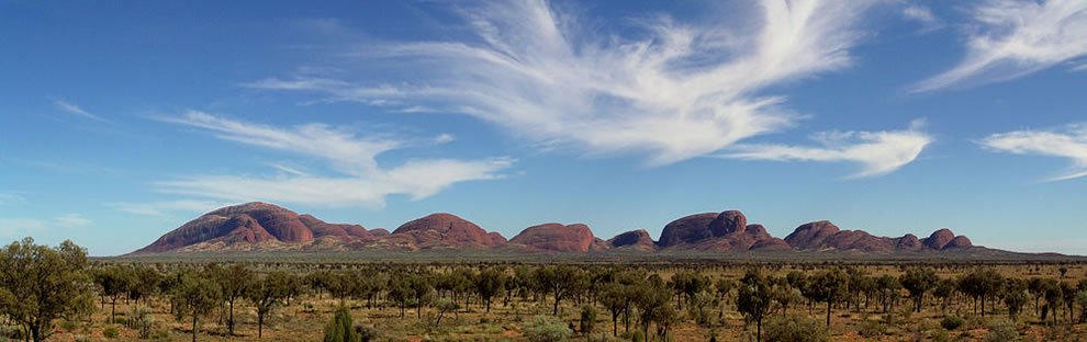 A panorama of Kata Tjuta. The Pitjantjajara name Kata Tjuta means 'many heads'. The site is as sacred to the Indigenous people as Uluru