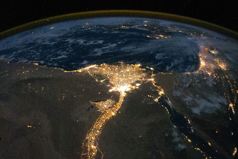 Lit up night view of the Nile River and its delta