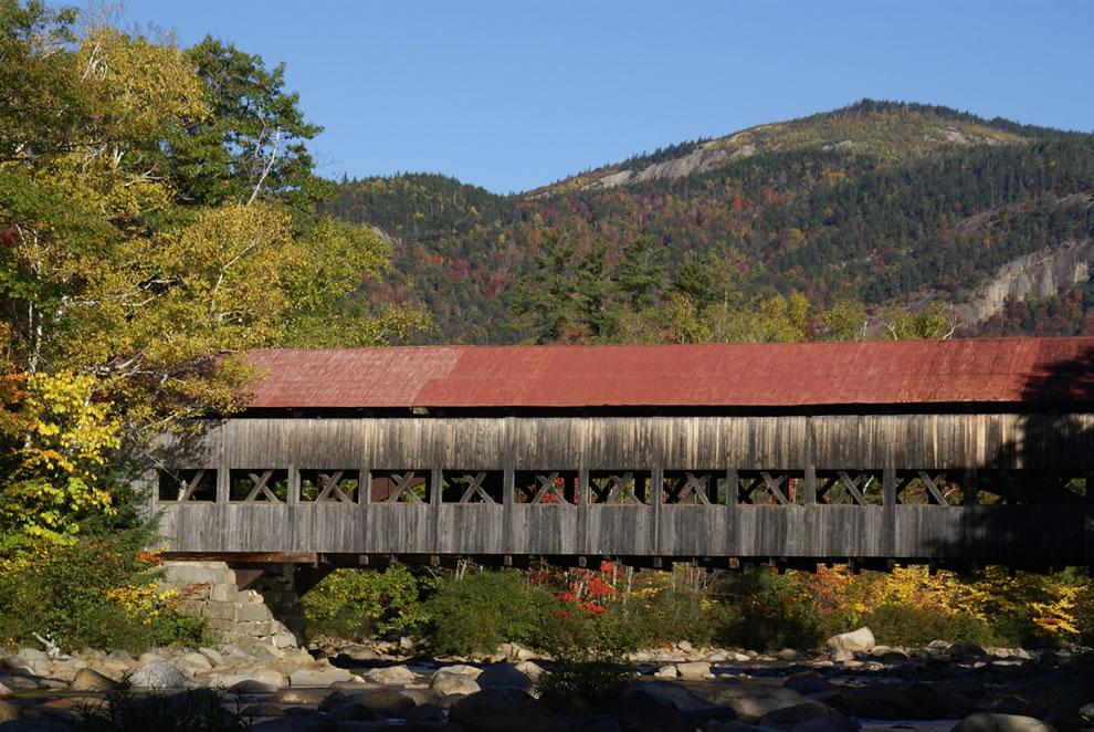 Albany Covered Bridge in New Hampshire during the fall