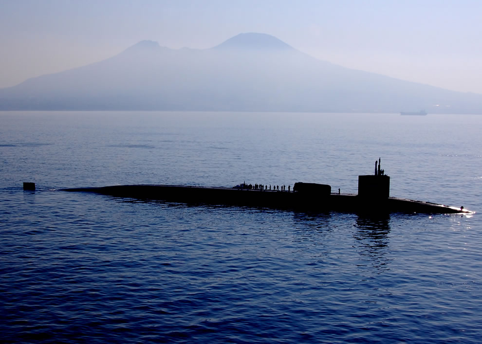The Ohio-class guided-missile submarine USS Georgia (SSGN 729) passes Mount Vesuvius after a port visit to Naples, Italy
