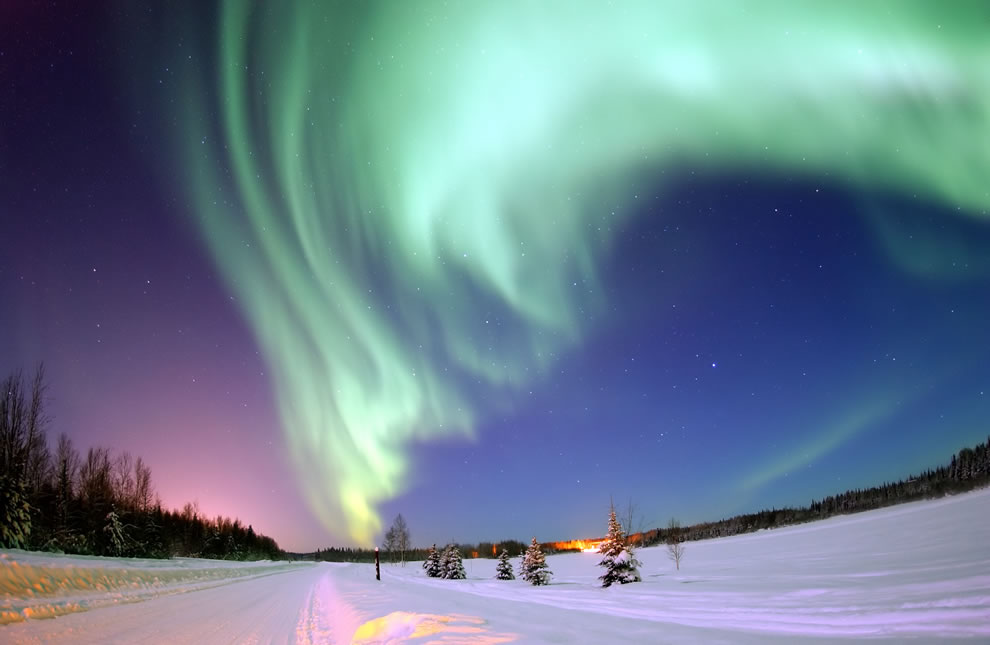 Arctic portal Eielson Air Force Base Alaska--The Aurora Borealis or Northern Lights shines above Bear Lake