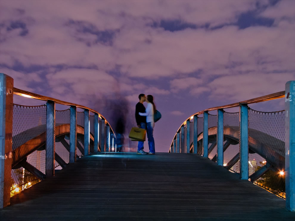 Midnight Kiss on a bridge