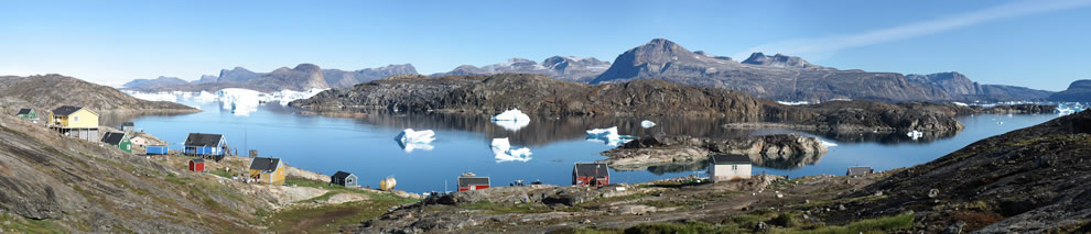 Panorama of the small settlement Naajaat in North-West Greenland. The Greenland ice sheet is seen to the upper left