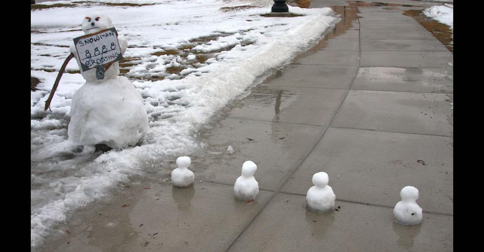 Calvin and Hobbes-esque Snowmen crossing