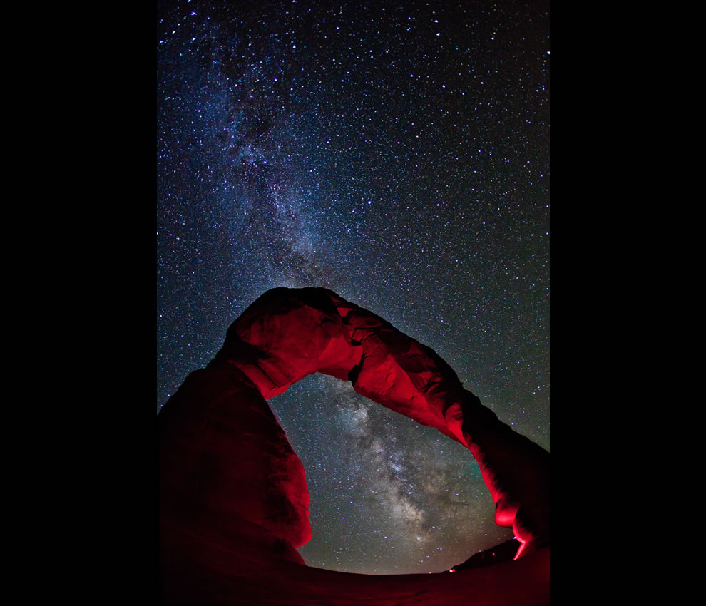 Moab, Utah -- The pride of Arches National Park; Delicate Arch, stretches towards the Milky Way
