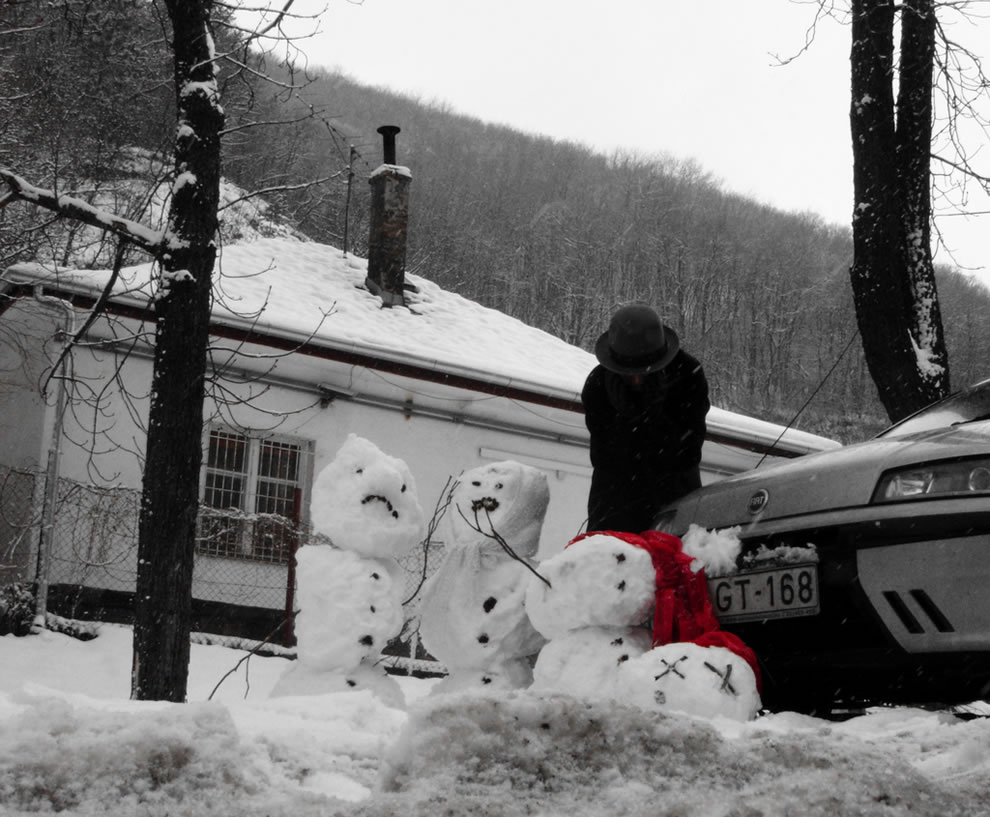 The Grieving Calvin and Hobbes-esque Snowman Family