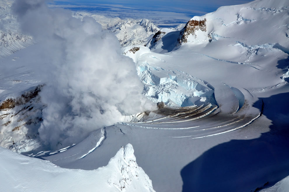 Fumarole on Mount Redoubt, Alaska, USA. One day before the eruption of 2009-03-22 the volcano shows steam venting and the summit glacier melting and breaking in an 'ice piston' feature