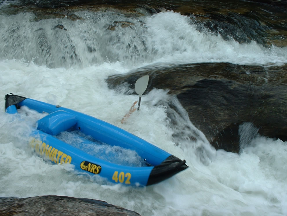 Bulls Sluice rapid on Chatooga River between Georgia and South Carolina, this shows a mishap in an inflatable kayak