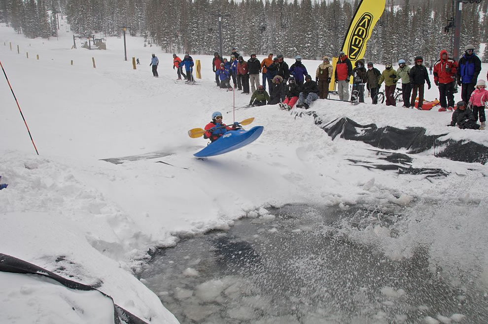 Snow kayaking Monarch Mountain jump