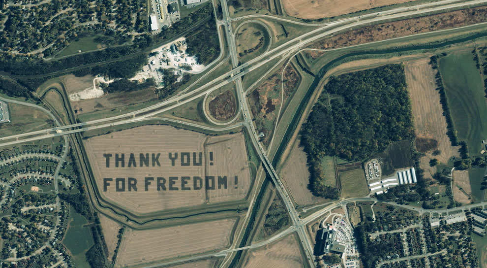 This 1-meter IKONOS satellite image depicts a crop field at Offutt Air Force Base in which the words 'Thank You! For Freedom!' are visible all the way from space